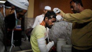 A man receiveds medical treatment at an Indian hospital