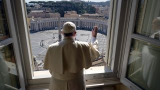 Pope Francis delivers his blessing from inside the Apostolic library at the Vatican