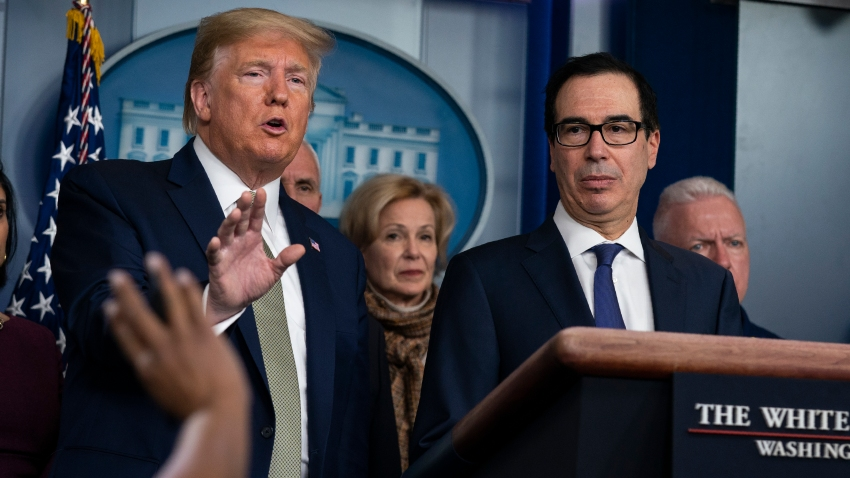 In this March 17, 2020, file photo, Treasury Secretary Steven Mnuchin, right, listens as President Donald Trump speaks during a press briefing with the coronavirus task force at the White House in Washington.