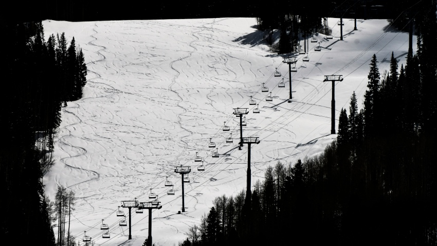 This Tuesday, March 24, 2020 photo shows ski lifts empty in Vail, Colo., after Vail Ski Resort closed for the season amid the COVID-19 pandemic.