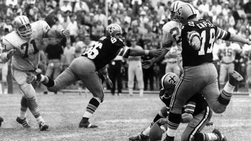 New Orleans Saints' Tom Dempsey moves up to kick a 63-yard field goal