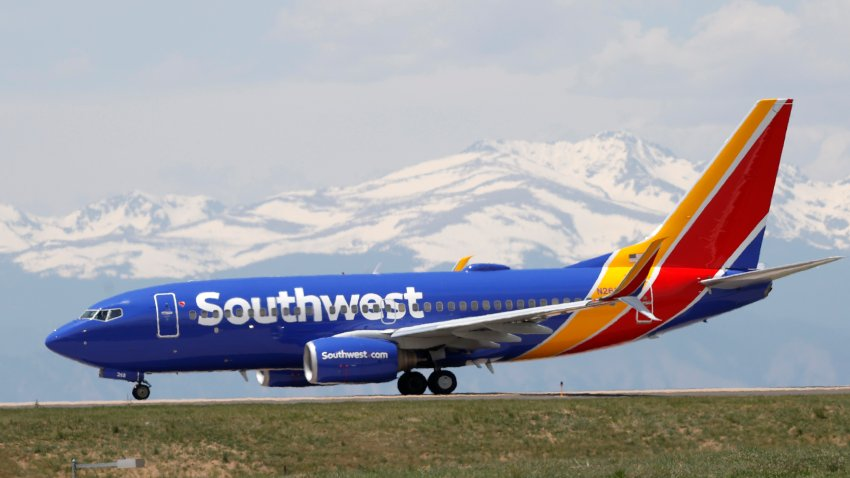 A Southwest Airlines jetliner taxis down a runway for take off from Denver International Airport as it gets back to life with the easing of restrictions to check the spread of the new coronavirus Wednesday, May 13, 2020, in Denver.