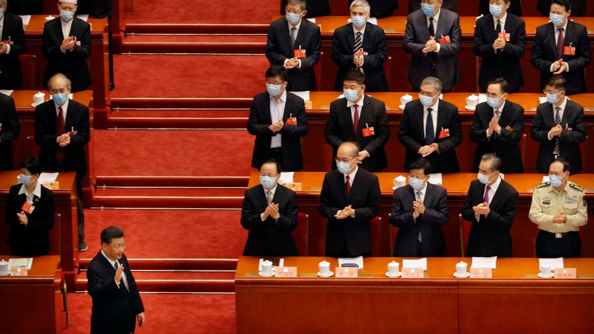 Chinese President Xi Jinping, left, gestures as he arrives for the opening session of the Chinese People's Political Consultative Conference (CPPCC) at the Great Hall of the People in Beijing, Thursday, May 21, 2020.