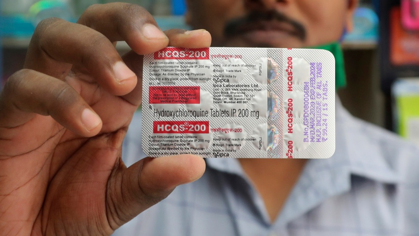In this Tuesday, May 19, 2020 file photo, a chemist holds a pack of hydroxychloroquine tablets in Mumbai, India. A Friday, May 22, 2029 report in the journal Lancet shows malaria drugs pushed by U.S. President Donald Trump as treatments for the coronavirus not only did not help but were tied to a greater risk of death and heart rhythm problems in a study of nearly 100,000 patients around the world.