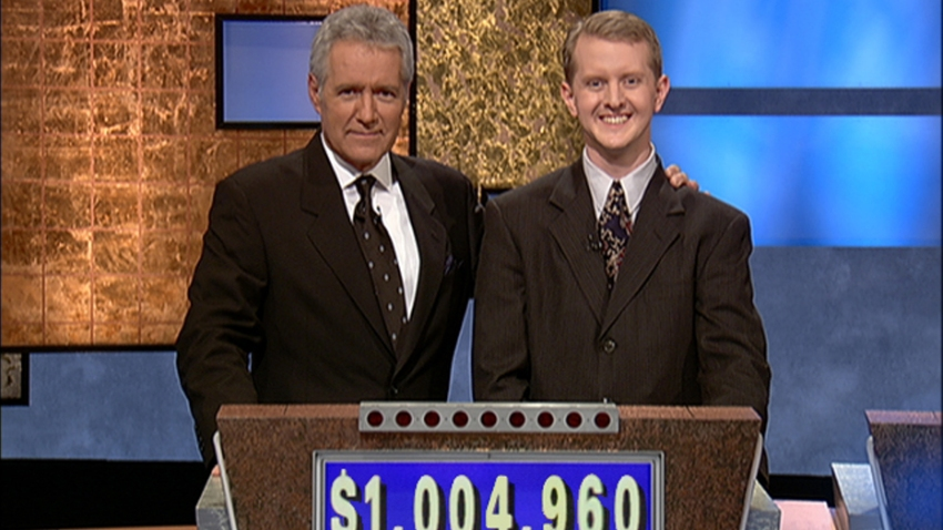 "In this July 14, 2004, file photo, ""Jeopardy!"" host Alex Trebek poses with contestant Ken Jennings after his earnings from his record breaking streak on the gameshow surpassed $1 million in Culver City, California."
