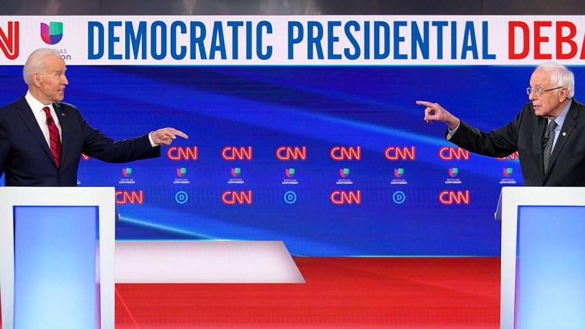 Democratic presidential hopefuls Joe Biden and Bernie Sanders point fingers during the 11th Democratic 2020 presidential primary debate in a CNN studio, March 15, 2020, in Washington, D.C.