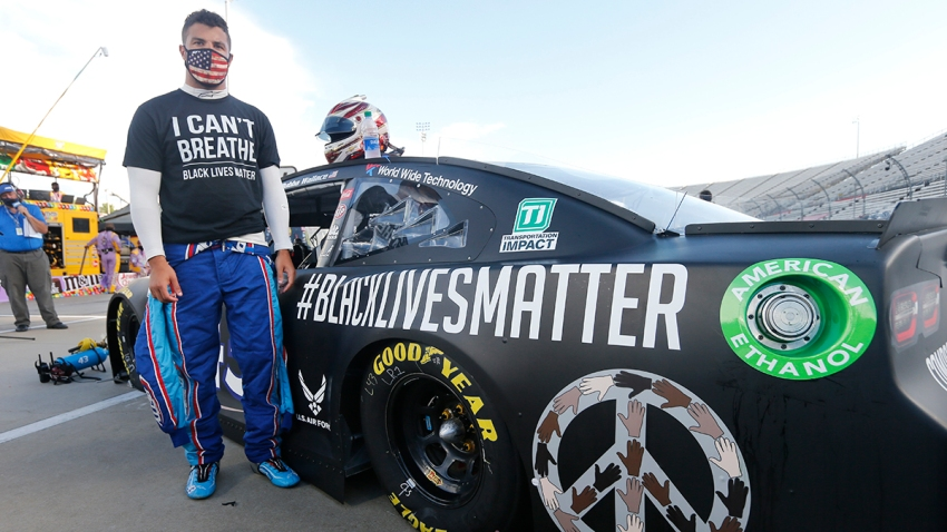 In this June 10, 2020, file photo, driver Bubba Wallace waits for the start of a NASCAR Cup Series auto race in Martinsville, Va.