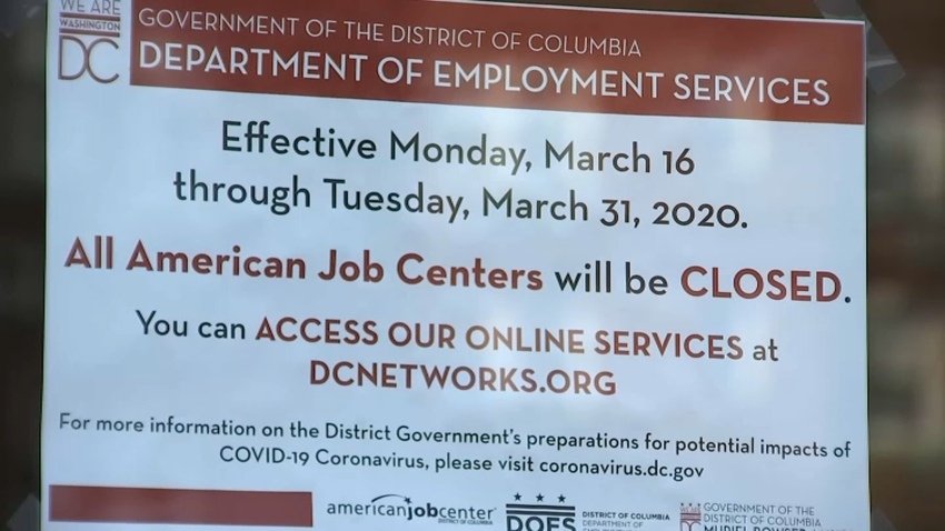 A sign instructs unemployment applicants in D.C. to file online.