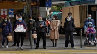 China Reports 1,886 New Virus Cases, Death Toll Up by 98
