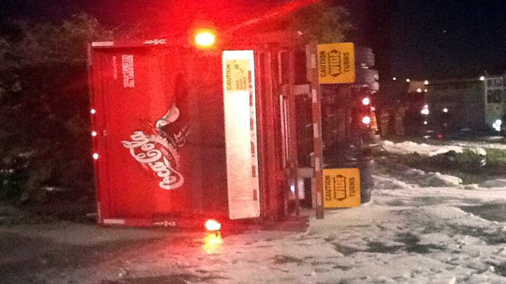 Flipped-over Coca-Cola truck