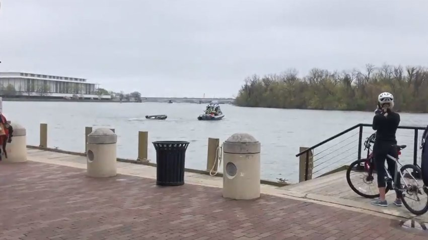 A boat does doughnuts on the Potomac River after hitting a wave and tossing its driver.