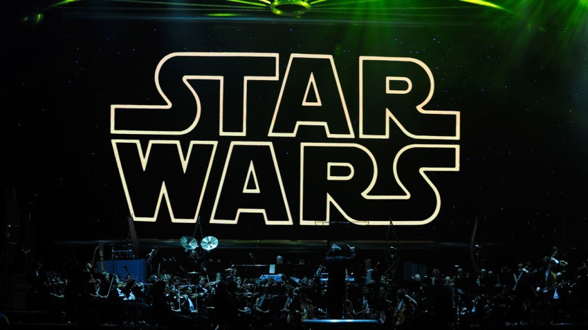 """In this file photo, the opening title from the Star Wars film series is shown on screen while musicians perform during """"Star Wars: In Concert"""" at the Orleans Arena May 29, 2010 in Las Vegas, Nevada."""