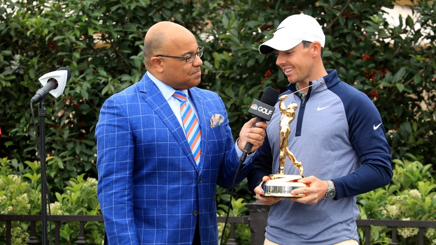Rory McIlroy of Northern Ireland holds the new Players Championship trophy as he is interviewed by Mike Tirico after his one shot win as fans take photographs with their phones during the final round of The Players Championship on the Stadium Course at TPC Sawgrass on March 17, 2019 in Ponte Vedra Beach, Florida.