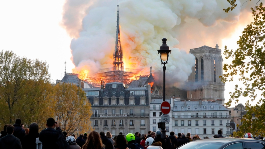 In this April 15, 2019, file photo, smoke and flames rise during a fire at the landmark Notre Dame Cathedral in central Paris.