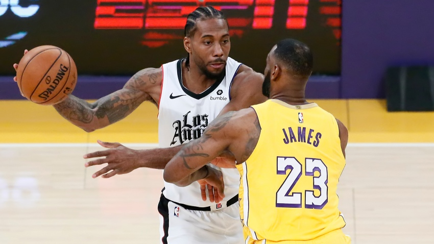 LeBron James of the Los Angeles Lakers guards Kawhi Leonard of the Los Angeles Clippers on Dec. 25, 2019, at STAPLES Center in Los Angeles.