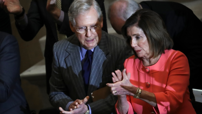WASHINGTON, DC JANUARY 15: (L-R) Speaker of the House Nancy Pelosi and Senate Majority Leader Mitch McConnell briefly speak with each other as they attend a Congressional Gold Medal ceremony at the U.S. Capitol on January 15, 2020 in Washington, DC. Congress awarded the Congressional Gold Medal to former NFL player and advocate for patients with Lou Gehrig's disease (ALS) Steve Gleason.