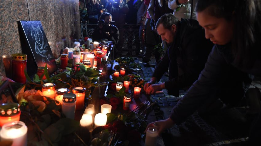 People light candles for Hanau shooting viictims