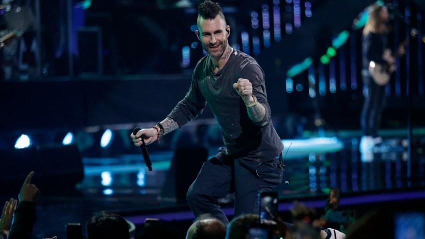 Adam Levine performs onstage