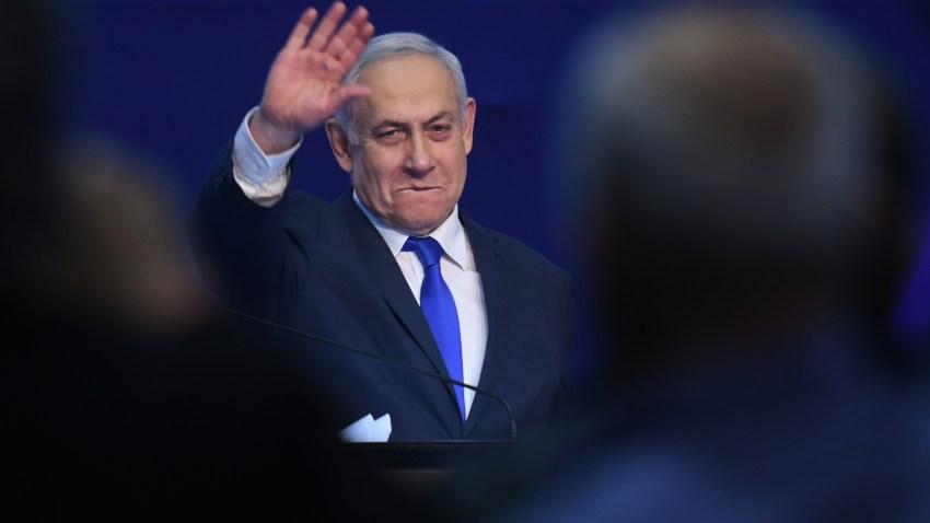 Israeli Prime Minister Benjamin Netanyahu gestures as he speaks to supporters