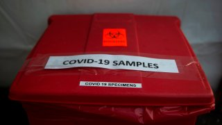 A bucket used to collect samples after people have been tested for coronavirus, COVID-19, is seen at a drive through testing site in Arlington, Virginia on March 20, 2020