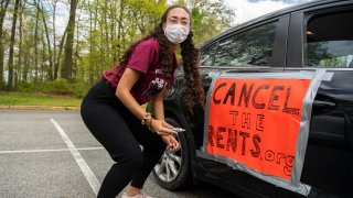 A demonstrator prepares for a national day of car protest to cancel the rents drive through Washington, D.C., to call for the cancellation of rents, mortgages and related utility bills, for the duration of the COVID-19 crisis in Rock Creek Park on Saturday, April 25, 2020.