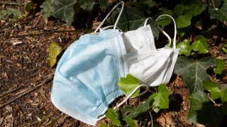 Surgical face masks discarded in public
