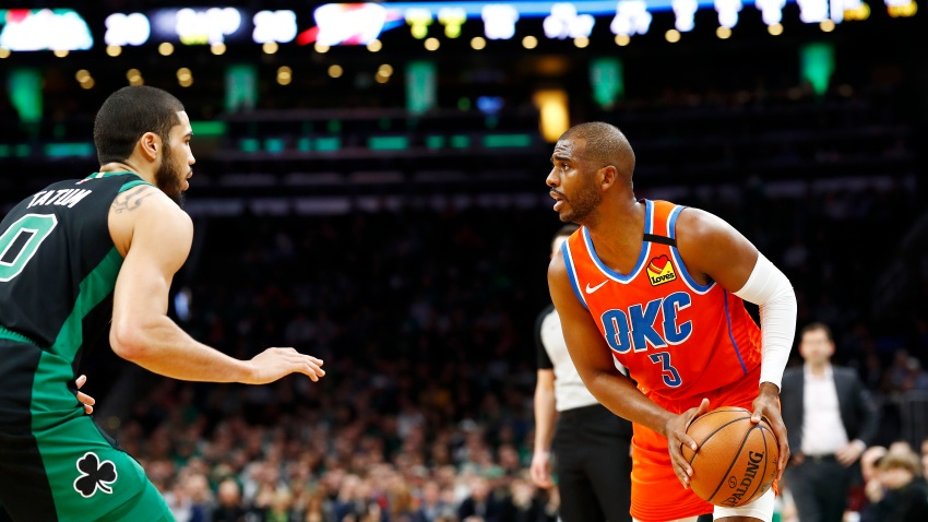Jayson Tatum of the Boston Celtics defends Chris Paul of the Oklahoma City Thunder during the first quarter of the game at TD Garden on March 8, 2020, in Boston.