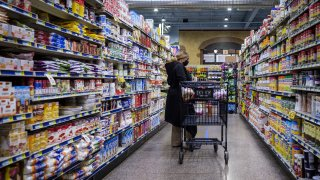 A shopper wearing a protective mask walks down an aisle at a grocery store in Chicago, on May 7, 2020.