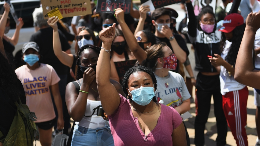 Protesters demonstrate against police brutality and the death of George Floyd outside the St. Louis City Justice Center and City Hall on June 1, 2020 in St Louis, Missouri. Protests continue to be held in cities throughout the country over the death of George Floyd, a black man who died while in police custody in Minneapolis on May 25.