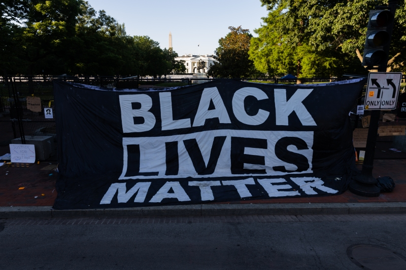Photos: New White House Fence Becomes Backdrop for Protest Art