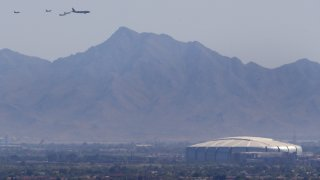 Luke AFB's 56th Fighter Wing and the 944th Fighter Wing and Arizona National Guard's 161st Air Refueling Wing fly over State Farm Stadium on May 1, 2020 in Glendale, Arizona.