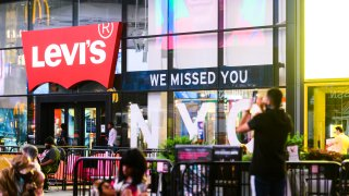 NEW YORK, NEW YORK - JULY 01: 'We missed you NYC' sign is seen outside the Levi's store in Times Square as New York City moves into Phase 2 of re-opening following restrictions imposed to curb the coronavirus pandemic on July 1, 2020. Phase 2 permits the reopening of offices, in-store retail, outdoor dining, barbers and beauty parlors and numerous other businesses. Phase 2 is the second of four phased stages designated by the state.