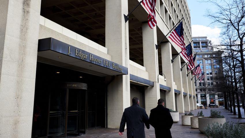 Pedestrians walk past the FBI headquarters in Washington, D.C.