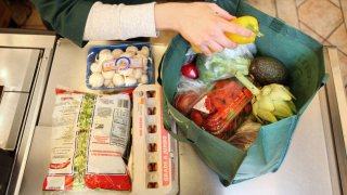 Woman bagging groceries