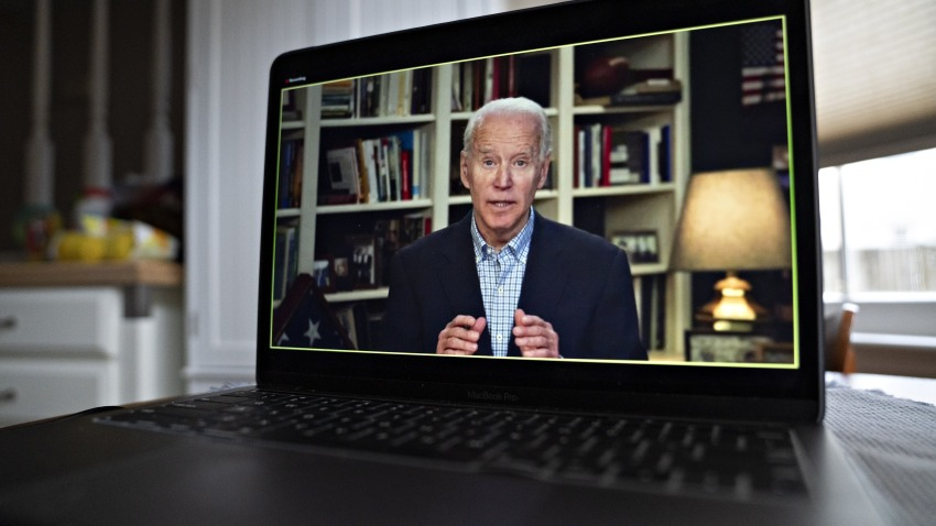 In this March 25, 2020, file photo, former Vice President Joe Biden, 2020 Democratic presidential candidate, speaks during a virtual press briefing on a laptop computer in this arranged photograph in Arlington, Virginia.