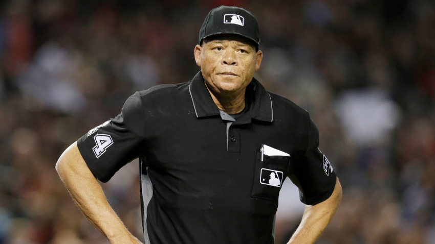 In this file photo, MLB umpire Kerwin Danley (44) stands on the field in the first inning during a baseball game between the Arizona Diamondbacks and the Miami Marlins, Saturday, June 2, 2018, in Phoenix.