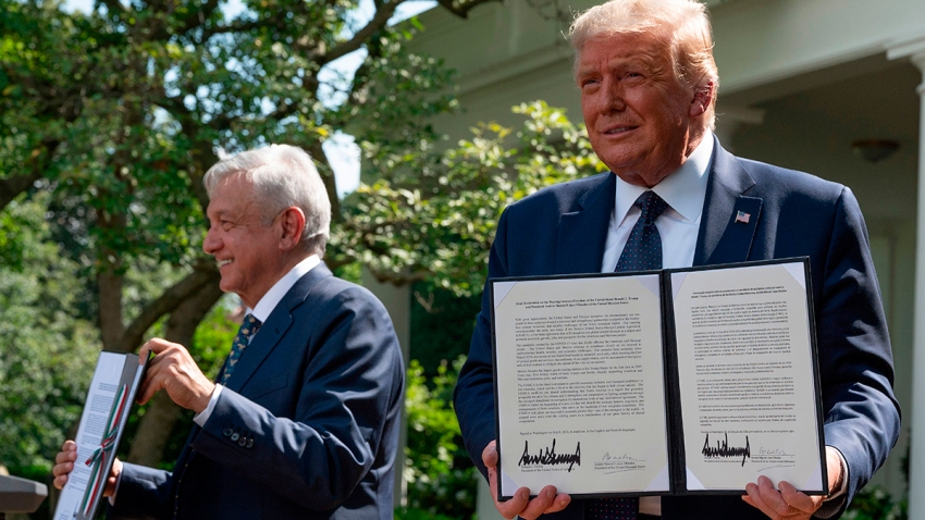 U.S. President Donald Trump and Mexican President Andres Manuel Lopez Obrador hold up a joint declaration during a joint press conference in the Rose Garden of the White House on July 8, 2020, in Washington, D.C.