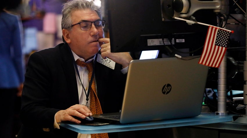 Trader John Bishop works on the floor of the New York Stock Exchange, Feb. 24, 2020.