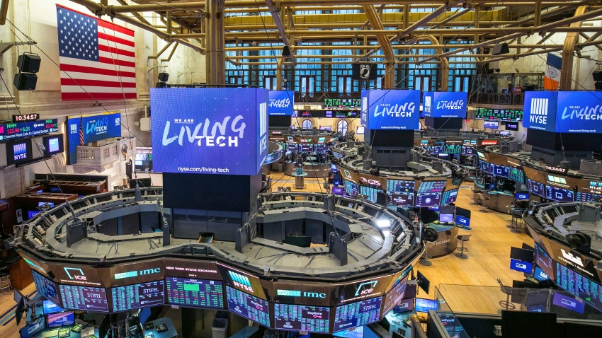 This file photo provided by the New York Stock Exchange shows the unoccupied NYSE trading floor, closed temporarily for the first time in 228 years as a result of coronavirus concerns, Tuesday March 24, 2020.