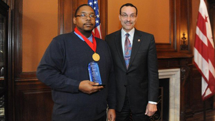 Mayor Vincent Gray awards Leo Johnson the medal of honor