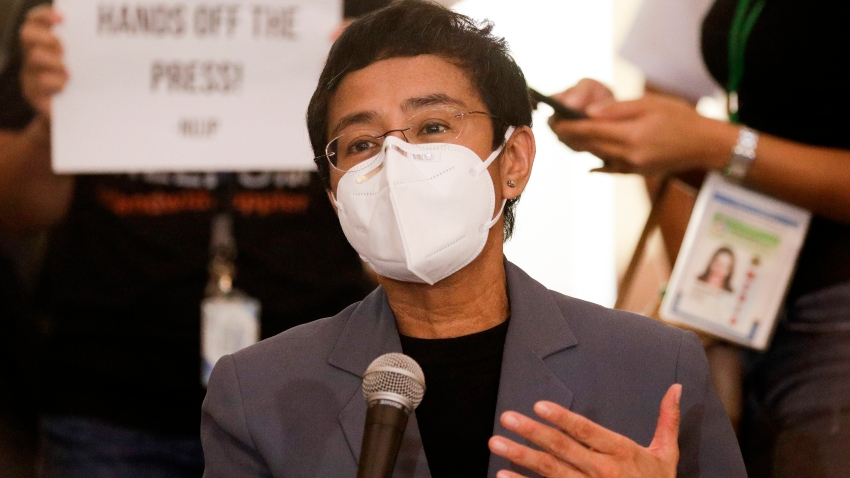 Rappler CEO and Executive Editor Maria Ressa gestures during a press conference near the Manila Regional Trial Court in Manila, Philippines on Monday June 15, 2020. Ressa, an award-winning journalist critical of the Philippine president, was convicted of libel and sentenced to jail Monday in a major blow to press freedom in an Asian bastion of democracy.