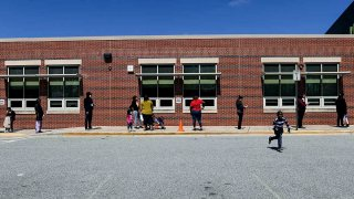 Parents wait in line during Montgomery County Chromebook distribution