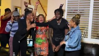 In this still image from video provided by the NFL, Brandon Aiyuk, second from right, is congratulated while watching the NFL football draft, Thursday, April 23, 2020, in Reno, Nev. The San Francisco 49er selected Aiyuk in the first round.