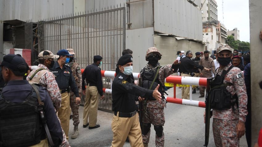 Security personnel gather at the main entrance of the Pakistan Stock Exchange building in Karachi on June 29, 2020.