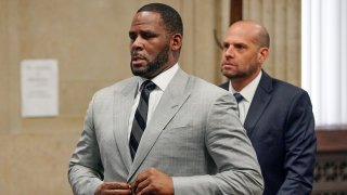 In this June 6, 2019, file photo, singer R. Kelly pleaded not guilty to 11 additional sex-related felonies during a court hearing before Judge Lawrence Flood at Leighton Criminal Court Building in Chicago. An updated federal indictment filed on Friday, Feb. 14, 2020, in Chicago, refers to yet another minor accusing R. Kelly of sexual misconduct, adding to the jailed singer's mounting legal challenges across three states.