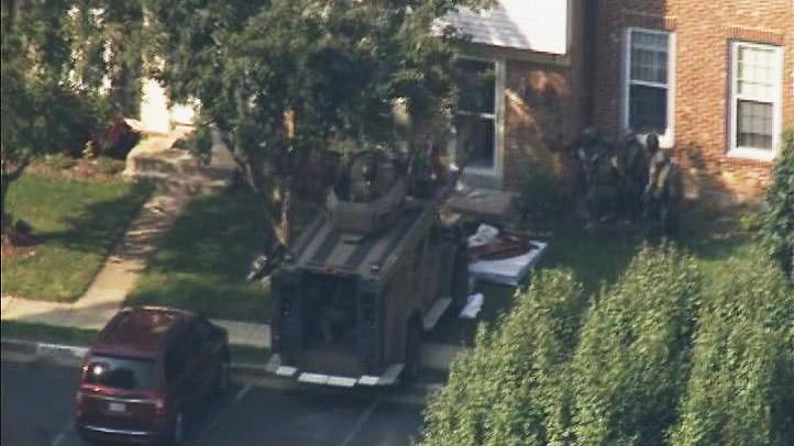 SWAT-Entering-Springfield-Home-Shot-Fire-Barricade