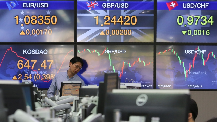 In this April 29, 2020, file photo, a currency trader watches monitors at the foreign exchange dealing room of the KEB Hana Bank headquarters in Seoul, South Korea.