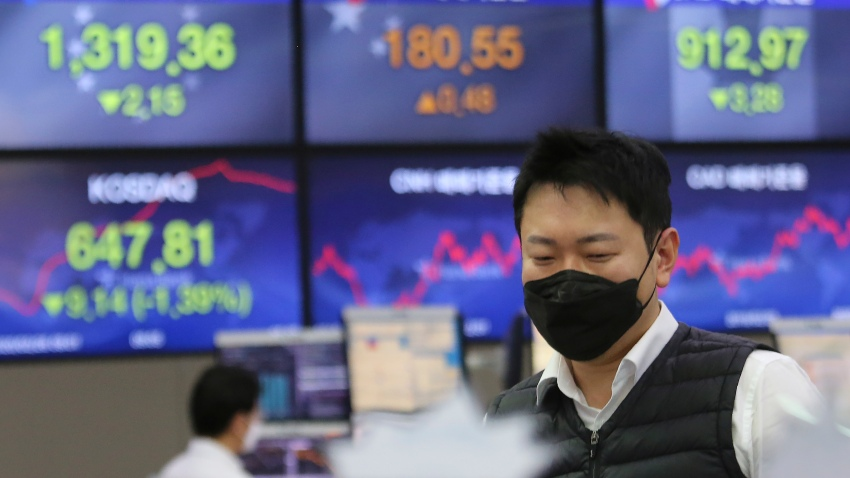In this Feb. 26, 2020, file photo, a currency trader watches monitors at the foreign exchange dealing room of the KEB Hana Bank headquarters in Seoul, South Korea.