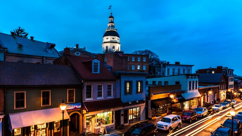 Maryland State Capitol is seen at dusk above Main Street Annapolis, Maryland.