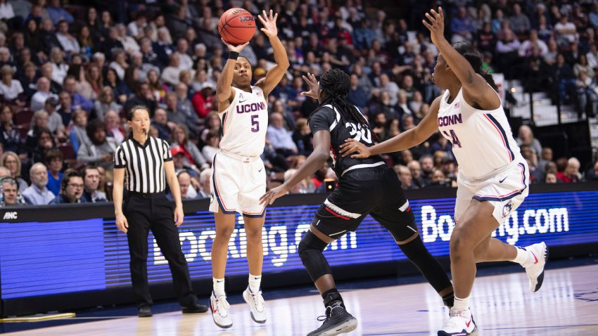 Crystal Dangerfield #5 of the UConn Huskies during the American Athletic Conference women's basketball championship at Mohegan Sun Arena